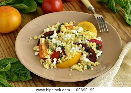 Millet with basil and fresh tomatoes and goat cheese