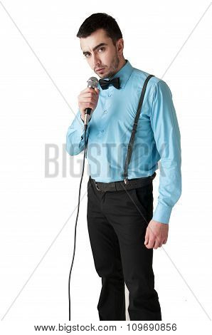 Gallant Man Holding A Microphone - Isolated On White Background.