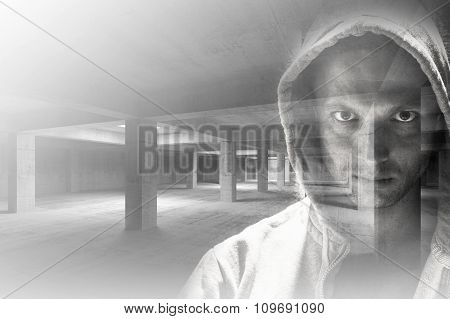 Man In Hood Combined With Empty Industrial Interior