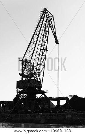Dark Silhouette Of Industrial Port Crane. Bulgaria