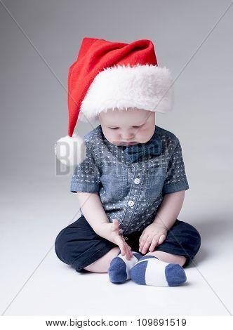 Serios baby boy in Santa hats