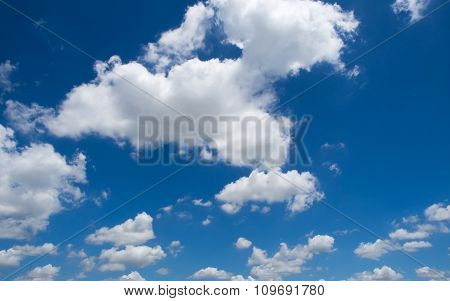 Blue Sky Background With White Clouds On The Bright Day Summer.