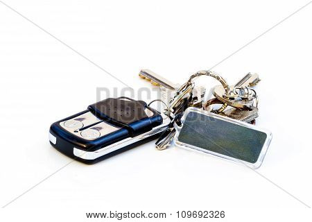 Key And Remote With Sign Blank On  White Table