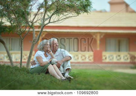 Senior couple near hotel