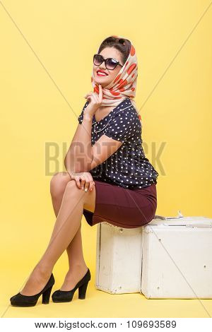 Cheerful pin-up girl is ready for trip