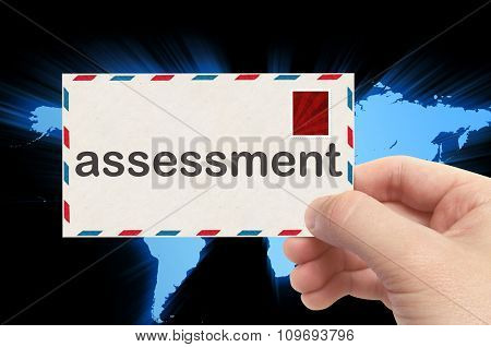 Hand Holding Envelope With Assessment Word And World Background