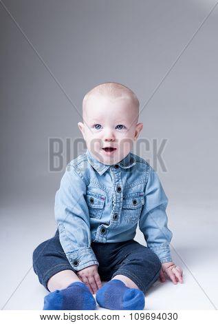 Surprised Baby Boy In Denim Shirt