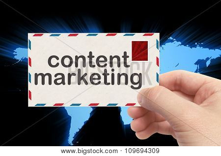 Hand Holding Envelope With Content Marketing Word And World Background