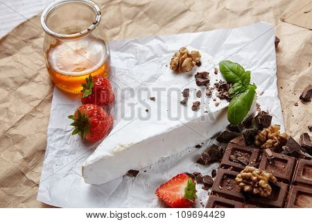 Side View Breakfast Set With Fresh Brie, Strawberries, Honey And Chocolate