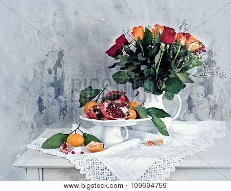 Still Life With Red Pomegranate, Orange Tangerines And Roses