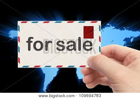 Hand Holding Envelope With For Sale Word And World Background