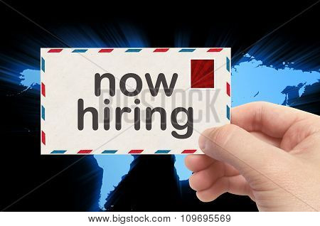 Hand Holding Envelope With Now Hiring Word And World Background
