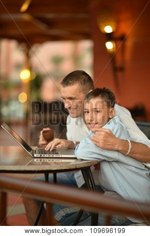 Father and son with laptop