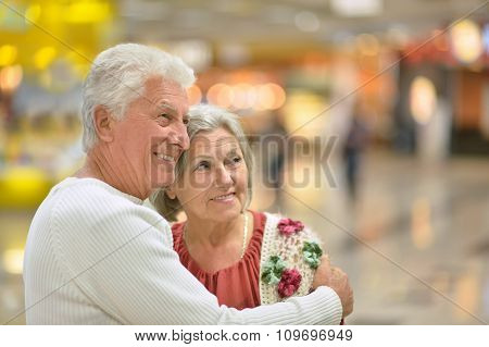 senior couple in  shopping center