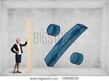 Businesswoman with wooden ruler