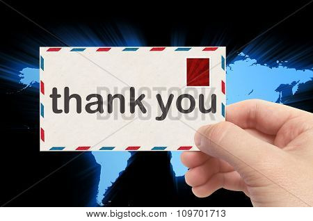 Hand Holding Envelope With Thank You Word And World Background