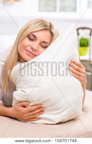 Young woman enjoying the softness.