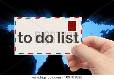 Hand Holding Envelope With To Do List Word And World Background