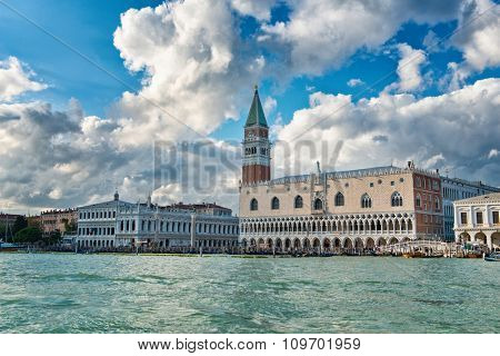 Doges Palace and St Marks Campanile, Venice , Italy with dramatic white clouds overhead viewed over the water of the Giudecca Canal