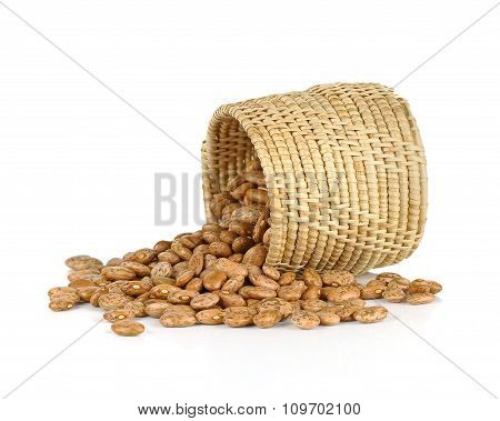 Spill The Beans - Pinto Beans Spilled From Basket Isolated On White Background