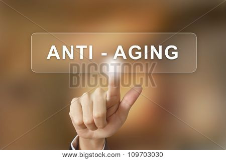 Business Hand Clicking Anti Aging Button On Blurred Background