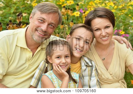 happy family at  blooming field