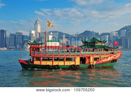 HONG KONG, CHINA - APR 23: Boat with city skyline on April 23, 2012 in Hong Kong, China. With 7M population and land mass of 1104 sq km, it is one of the most dense areas in the world.