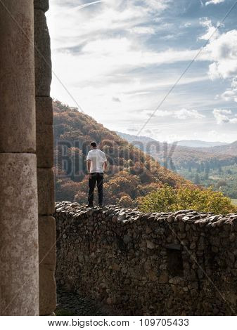 Man Walking On Wall