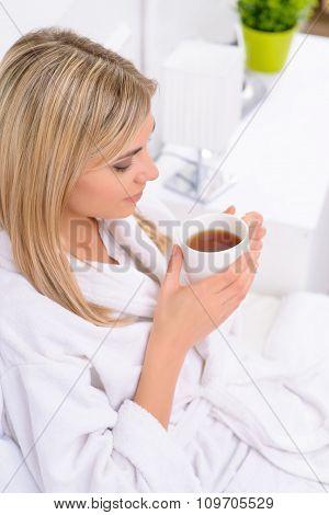 Hotel resident drinking her tea.