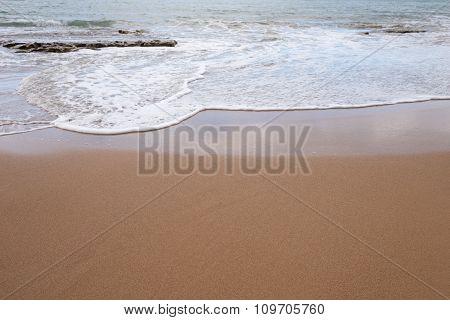 Ocean water and beach sand