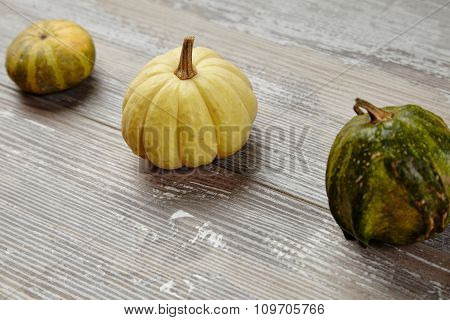 Trio Set Of Pupkins And Patison On Grunge Wooden Farm Table