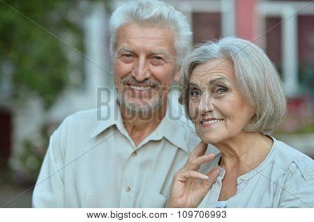mature couple  near house