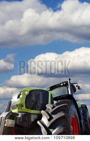 Big Tractor On Background Of The Cloudy Sky