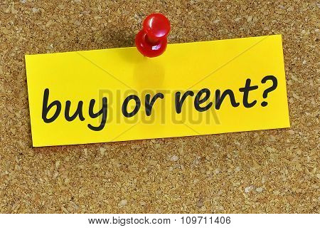 Buy Or Rent? Word On Yellow Notepaper With Cork Background