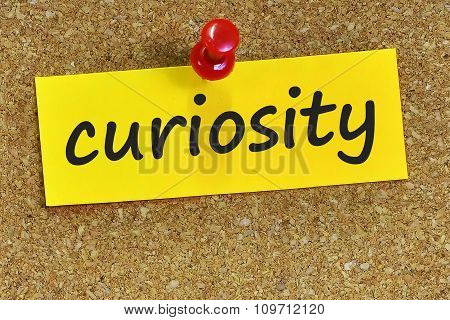 Curiosity Word On Yellow Notepaper With Cork Background