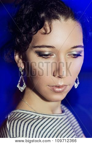 Young beautiful girl with a New Year's make-up