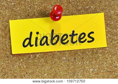 Diabetes Word On Yellow Notepaper With Cork Background