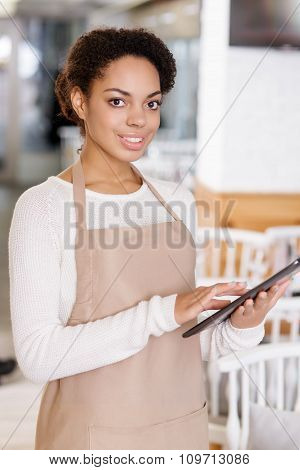 Waitress working with portable tablet.