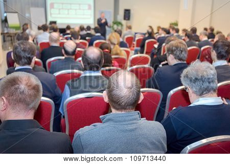 Business Conference: Rear View Of The People In A Conference Hall