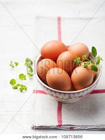 Eggs in a white bowl on beige napkin
