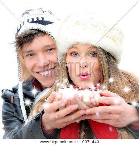 Happy Winter Couple Blowing A Christmas Wish