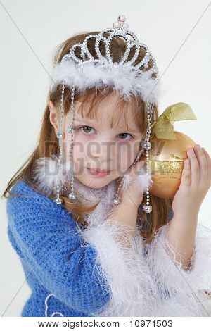 Little Girl In Christmas Clothes With Toy