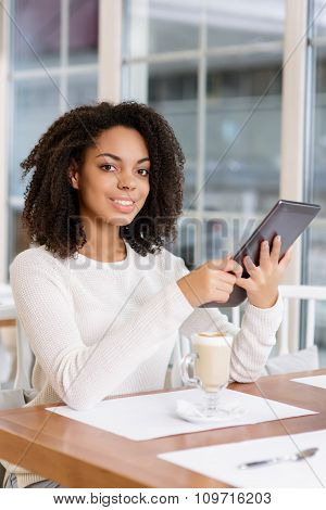 Restaurant customer posing with portable tablet.
