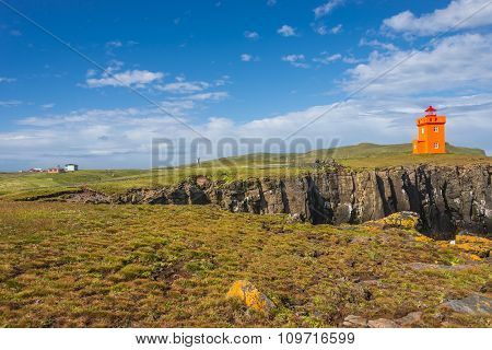 Orange Lighthouse At Seashore Of Grimsey Island Nearby Iceland, Summer Time