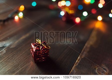 Christmas Gift On The Wooden Table