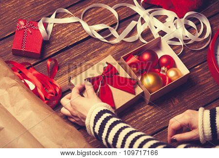 Female Hands And Christmas Gift Box