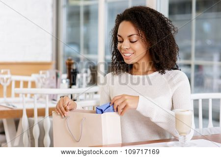 Young woman checking her shopping bag.