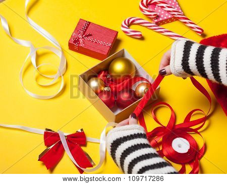 Female Hands Wrapping A Gift