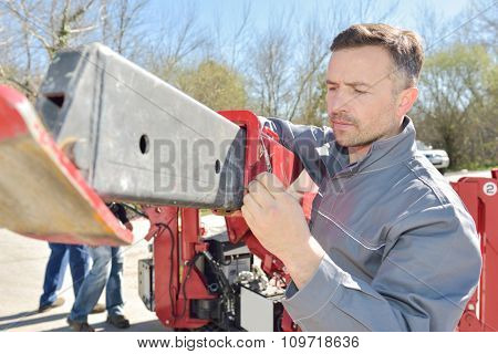Workman setting up machinery