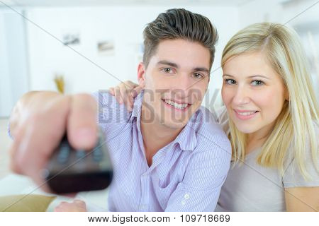 Couple using a remote control